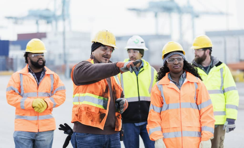 Photo of five young construction workers